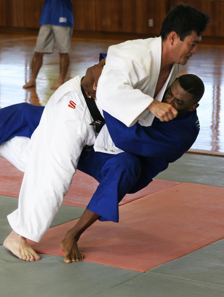 050907-M-7747B-002 GINOWAN CITY, OKINAWA, Japan – Shinya Kinjo (left) and 1st Lt. Tim A. Martin (right) go down to the ground during a Judo session at the Ginowan City Police Station Sept. 7. Kinjo is a Ginowan City police officer and Martin is the officer in charge of the Crime Prevention Unit at Camp Foster's Provost Marshal's Office. (Official U.S. Marine Corps photo by Lance Cpl. Scott M. Biscuiti)(released)