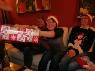 Gleefully grabbing for gifts