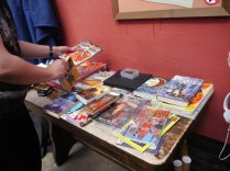 The table was full of comics and books