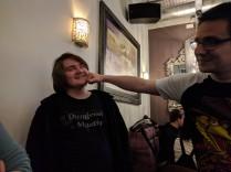 Ben hands Albert his trophy