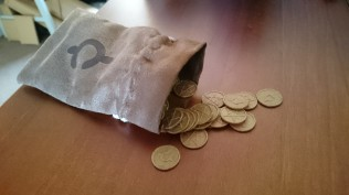 Flimsy coins, but they do the job. Furthermore, the rattle they make in this bag is glorious!